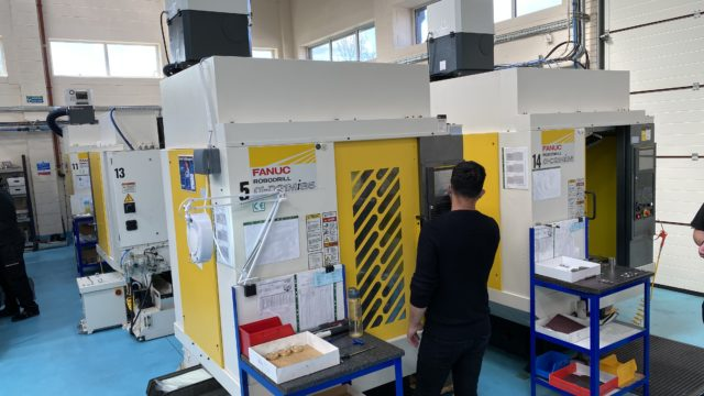 https://cdn.mtdcnc.global/cnc/wp-content/uploads/2021/07/08122715/Two-of-the-FANUC-5-axis-machining-centres-at-RG-Precision-640x360.jpg