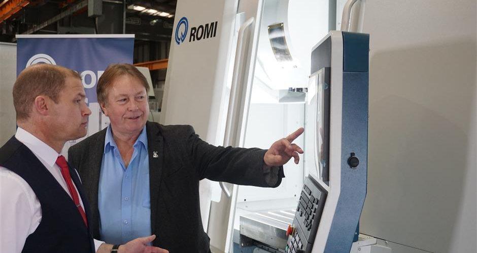 romi staff interacting with cnc machine