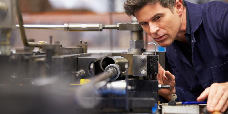 Engineer Looking at Machine